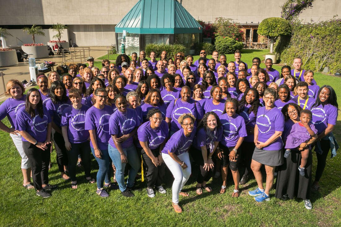 UnboundEd staff in purple shirts smiling at camera during the five-day Standards Institute