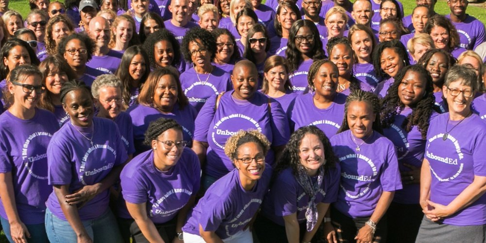 UnboundEd Staff wearing purple shirts at the Standards Institute and smiling